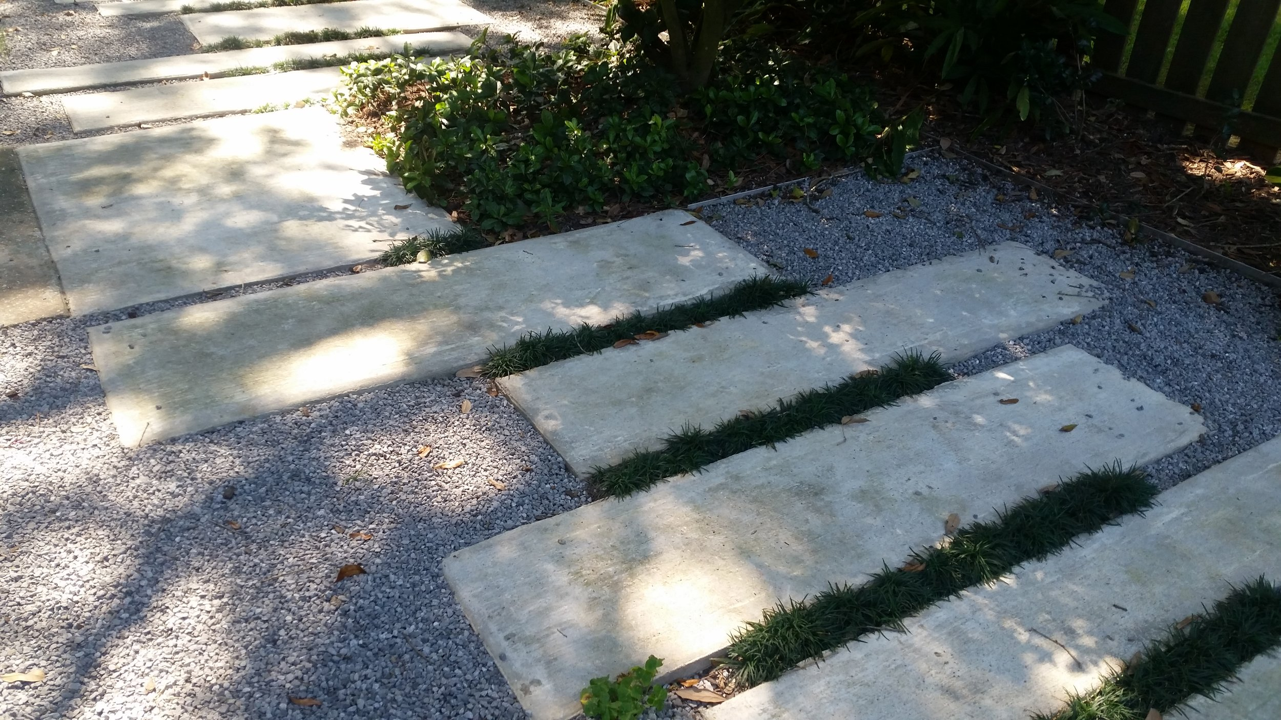 the front entry shows paver and walkable groundcover details