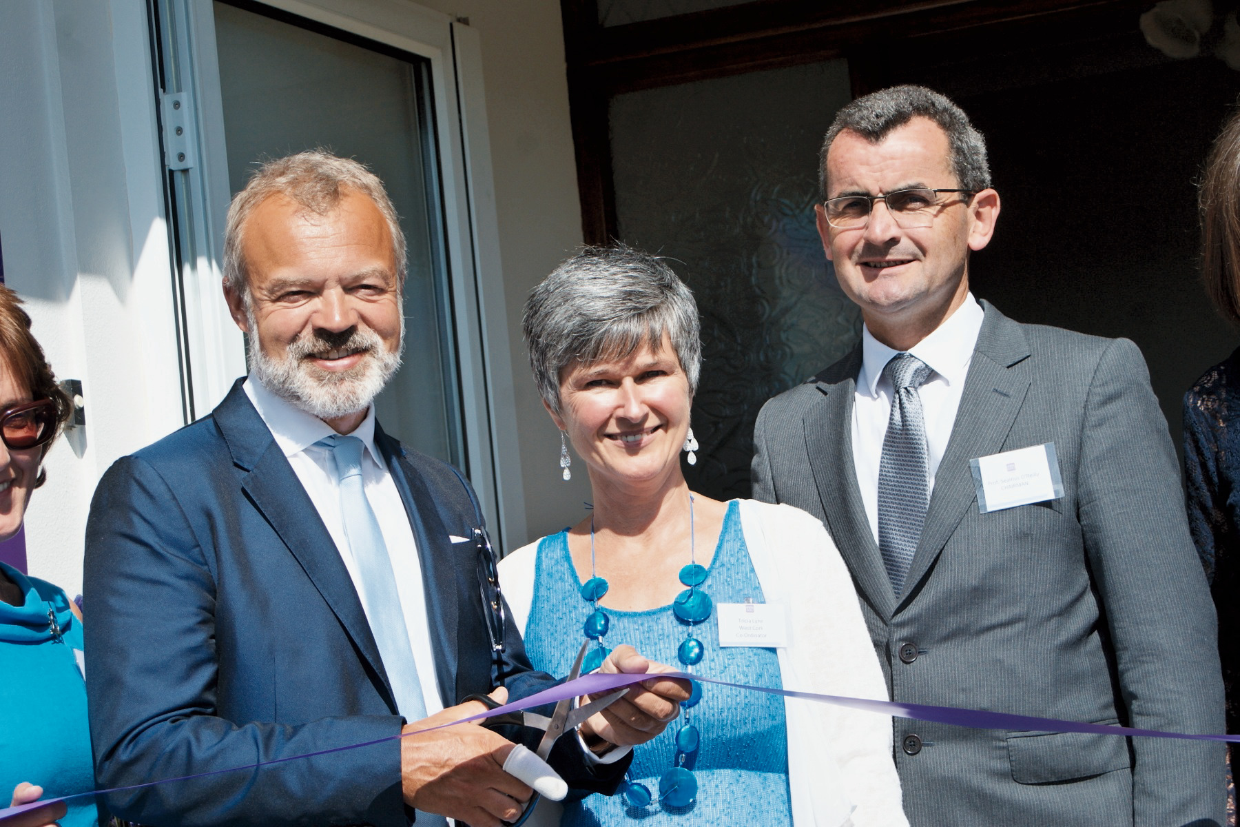 Graham Norton opening the Cork ARC Centre in Bantry August 15, with Patricia Lyne, West Cork Co-ordinator and Prof Seamus O'Reilly, Chairman, Board of Trustees.jpg