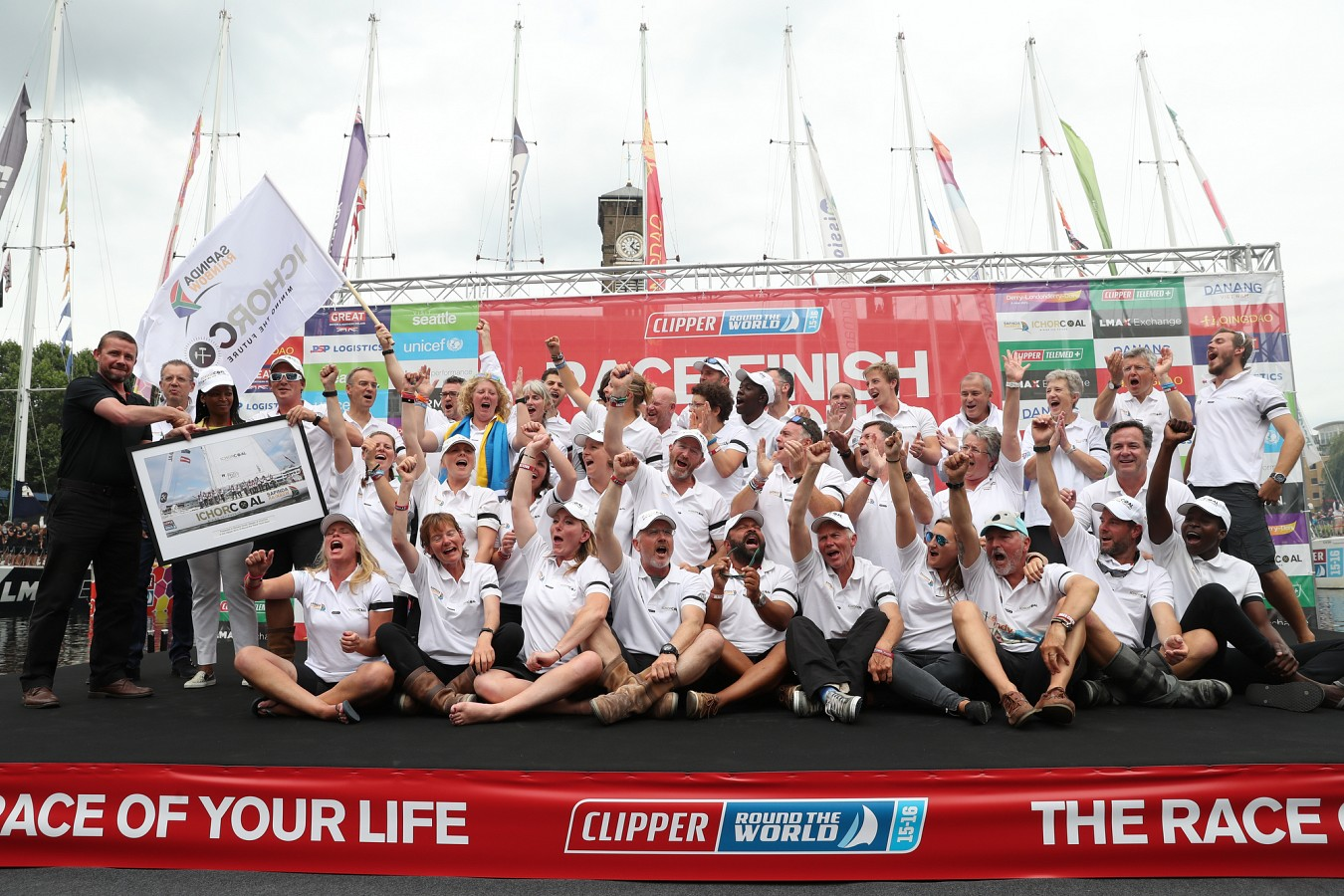 Trudy & the crew of Ichorcoal celebrating their massive acheivement on crossing the finish line