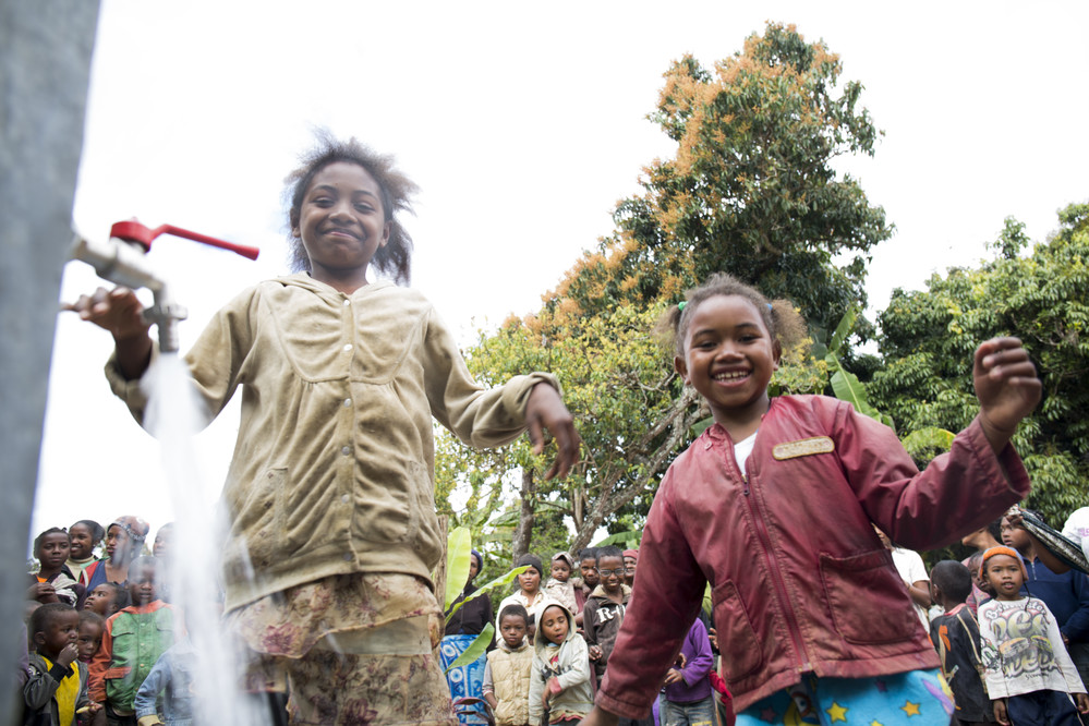 Time to celebrate! Now, thousands of children will have access to safe, drinkable water in this community.