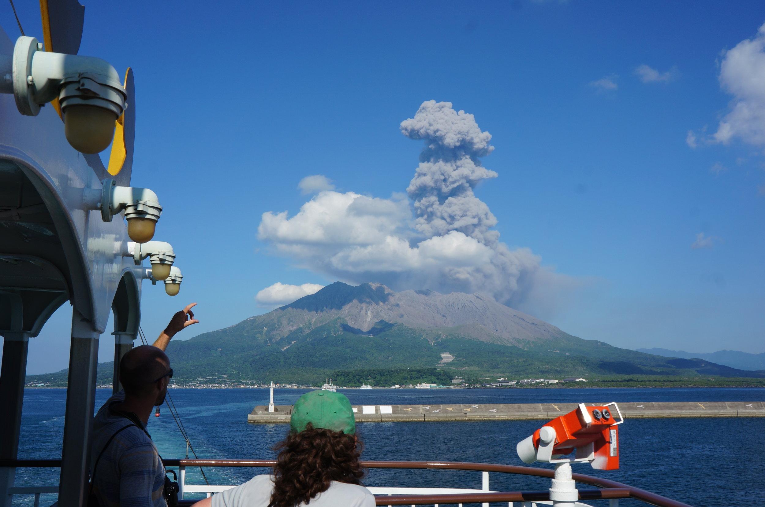 Watching eruption from ferry, Sakurajima Volcano, Japan -UAF Infrasound network deployment - July 2013, credit: C. Rowell