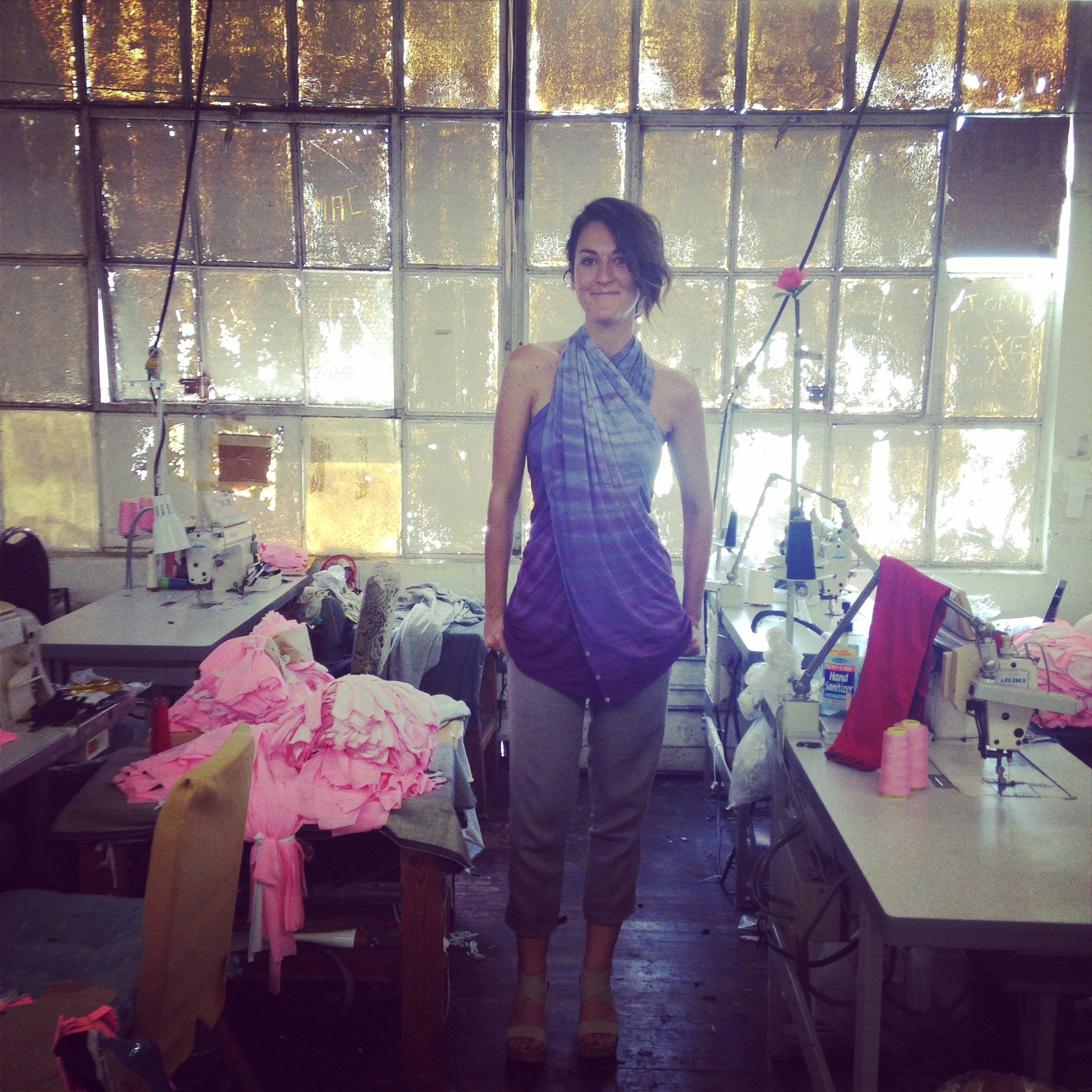Leilani, our sometimes collaborator, showing the cut & sew team  one of the many ways to wear the journey shawl  they're working on.