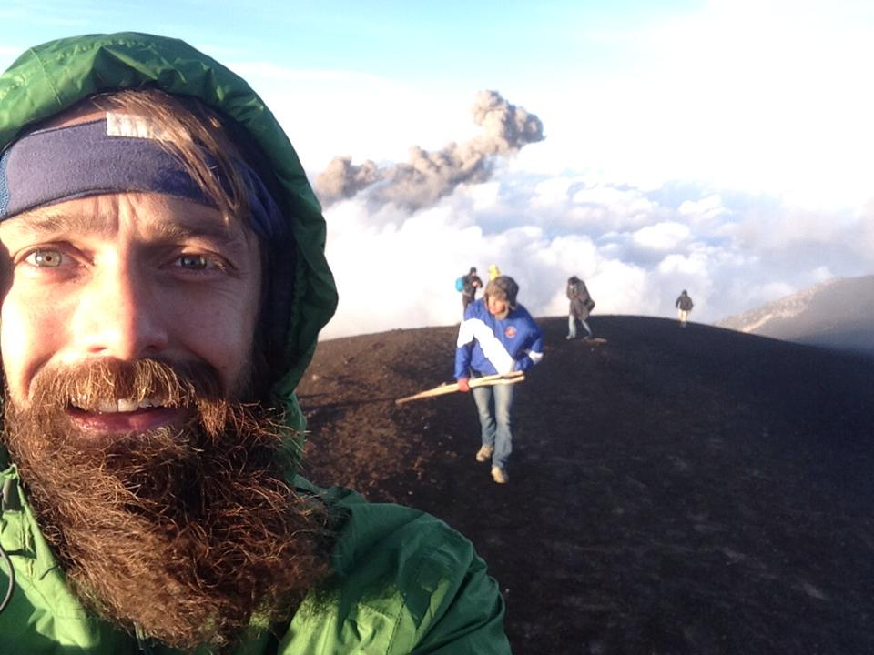beard,  crown blue men's headband  and gentlemen explorer on the slopes of a live volcano in guatemala
