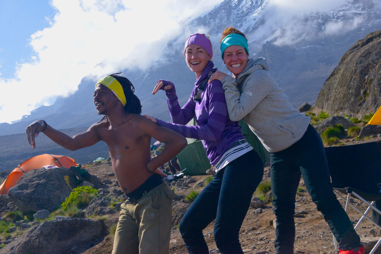 Melanie Trepanier, Olympic silver medalist Cheryl Bernard and their guide, Felix, on the slopes of Mt. Kilimanjaro