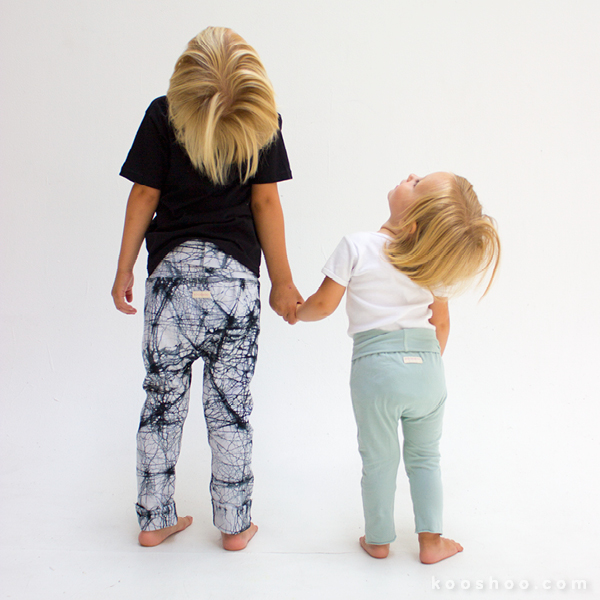 Black Batik kids pants size 4/5T on the left; Sage green solid kids pants size 6-18m on the right