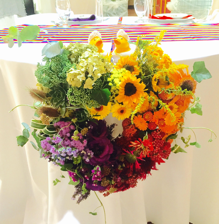 Rainbow wreath for sweetheart table - August wedding.