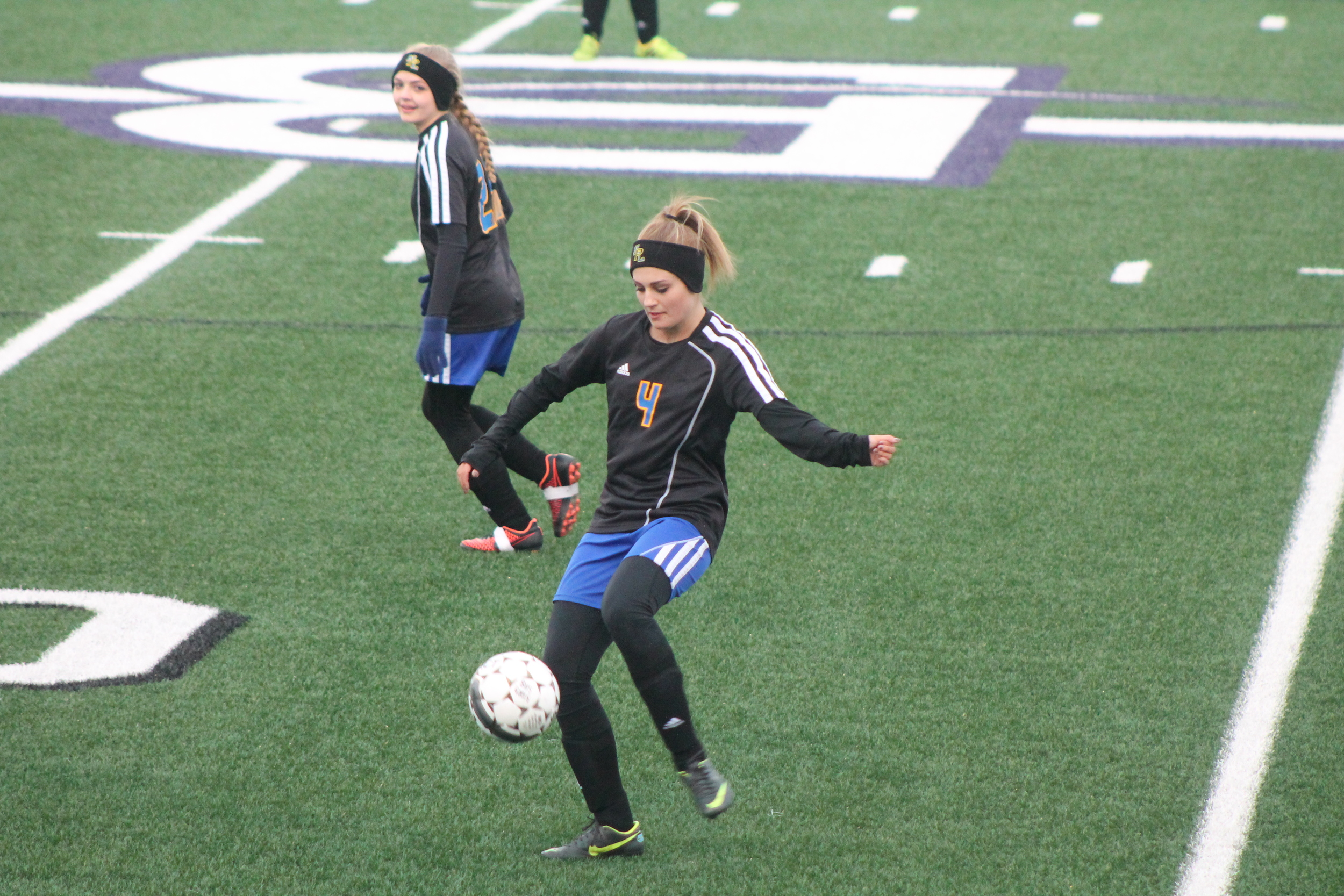 (Photo by Adam Routon) Abby Lacey controlling the ball for the Pantherettes against Bonham.