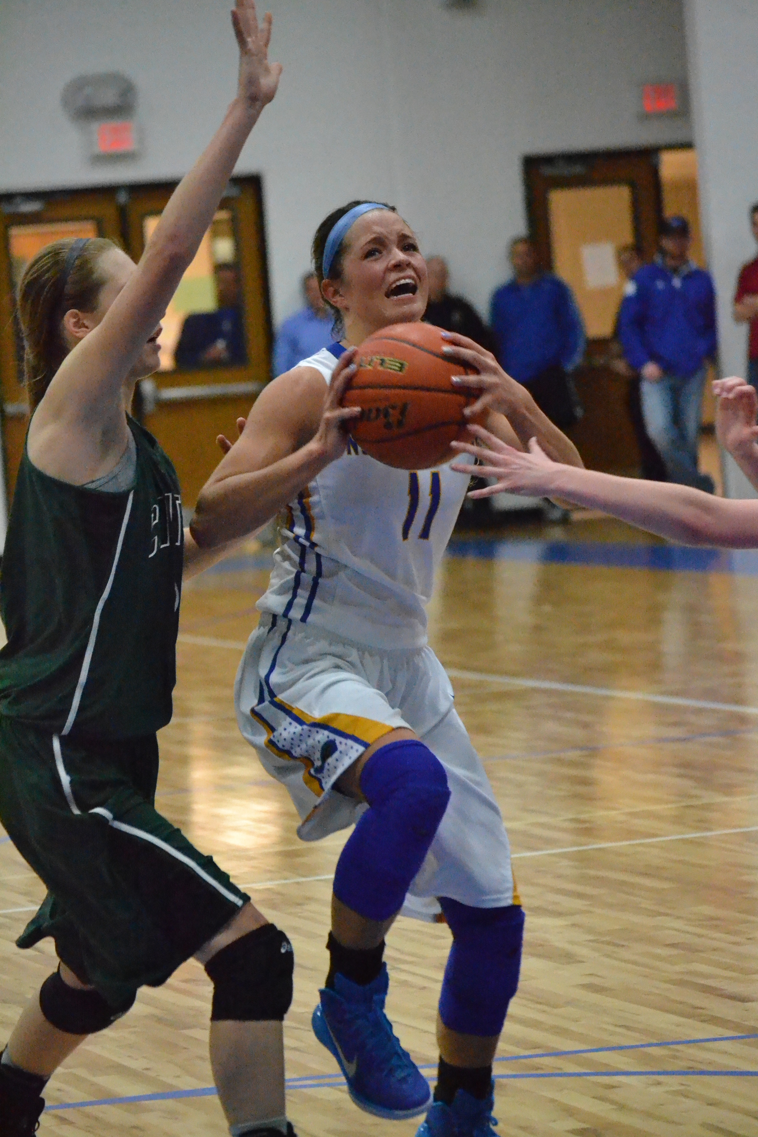 (Photo by Bev White) Kylie Hasltead driving to the lane for a layup attempt.