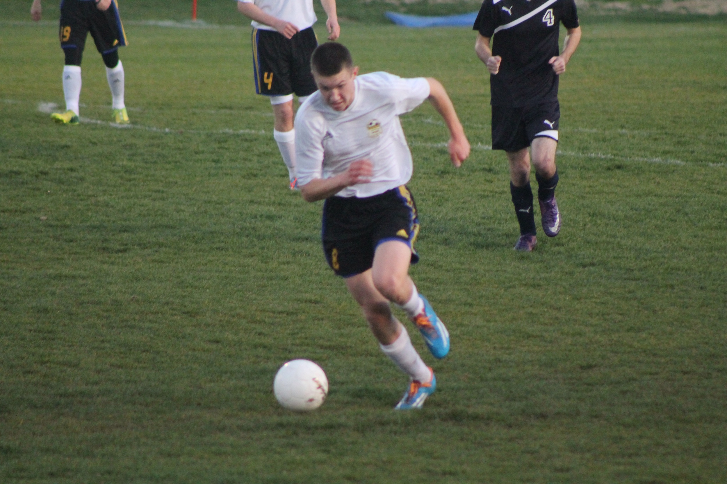 (Photo by Jared Routon) Grant Erickson pushes the ball up the field.