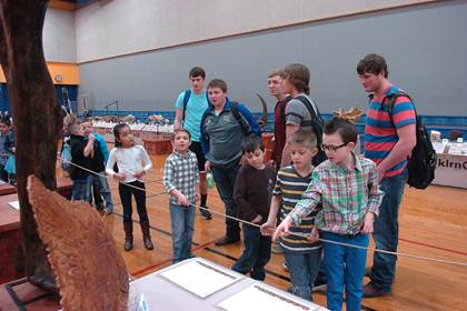 """Students of all ages toured the """"Dinosaur George"""" exhibit. North Lamar High School science students who meandered through the showing are Dakota Grissom, Anthony Rizzo, Maverick Priest, Sam Asay and Christian Miears. Studying the larger fossils alongside the upper classmen, from left, are Everett 2 nd graders Parker Scott, Cade Thoms, Joanna Ramirez, Laramy Smith, Seth LaRue, Blake Hoover, and Caleb Echols."""