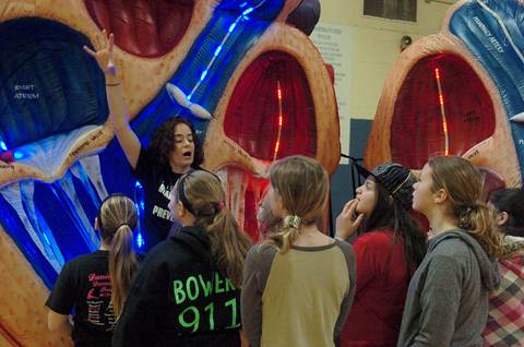 A Paris Cardiology Center team member guides North Lamar 5 th graders through a giant walk-through heart educating them on the heart's functions and risk factors associated with strokes.