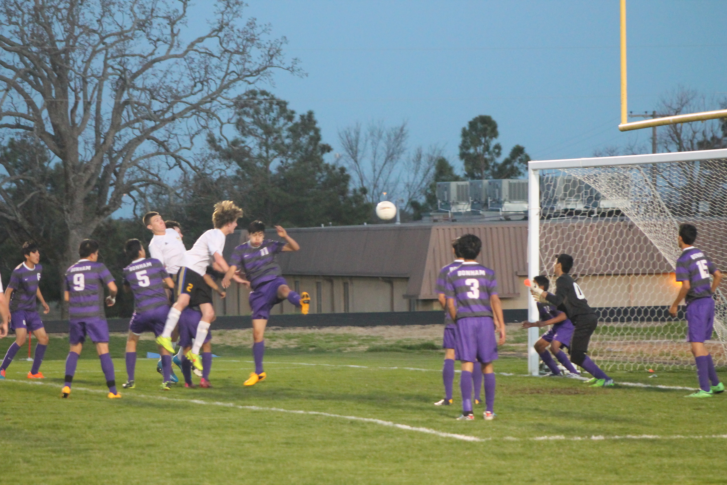 (Photo by Jared Routon) Hunter Loves attempts a header against Bonham