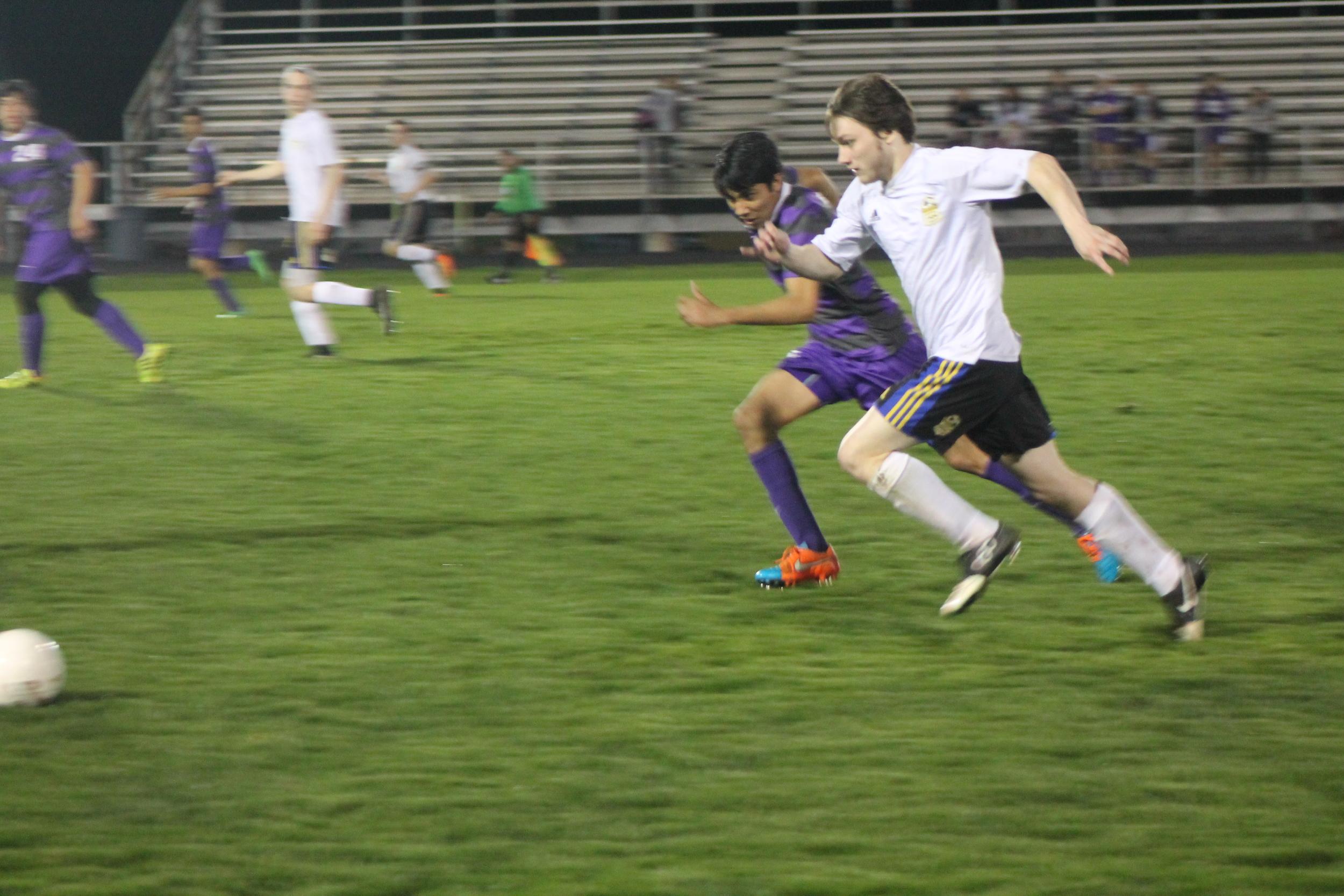 (Photo by Jared Routon) Chance Kent runs down the ball against Bonham