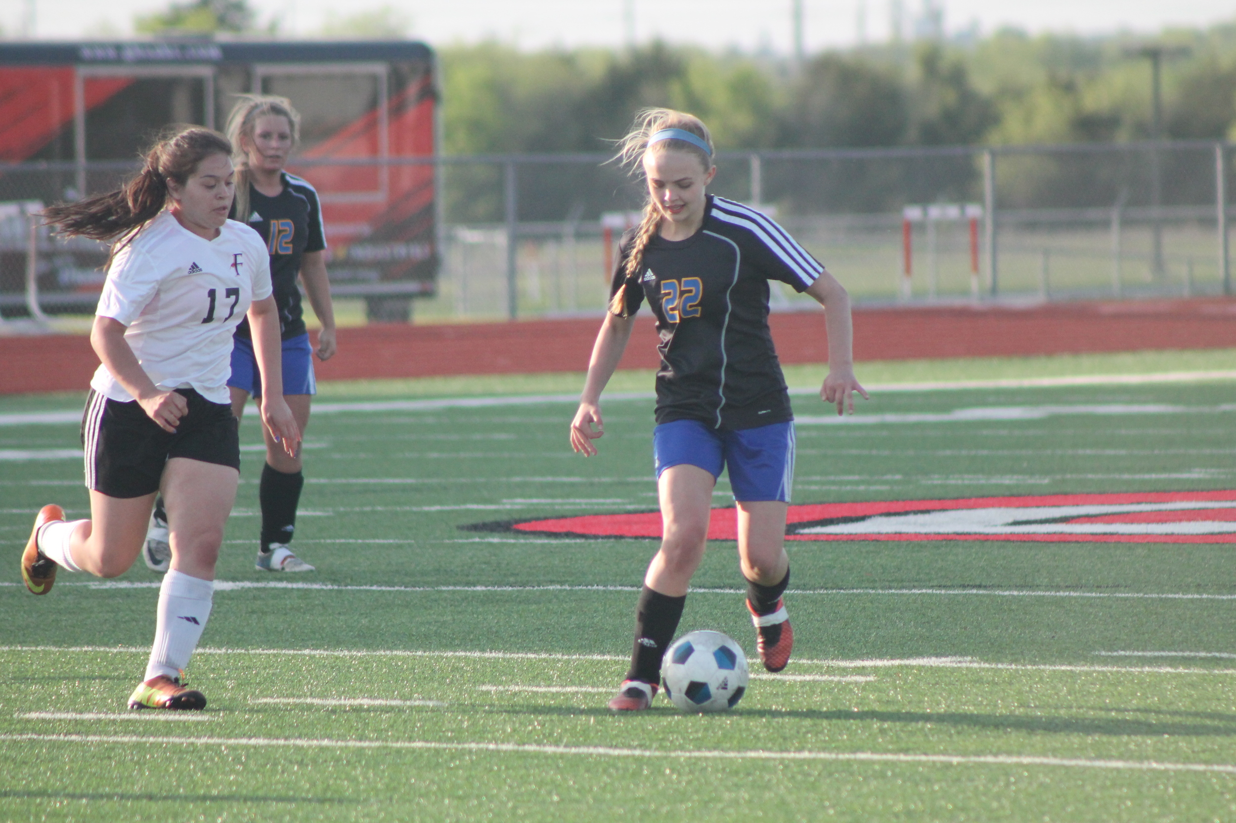 (Photo by Adam Routon) Katie Kilcrease kills another Ferris offensive attempt.