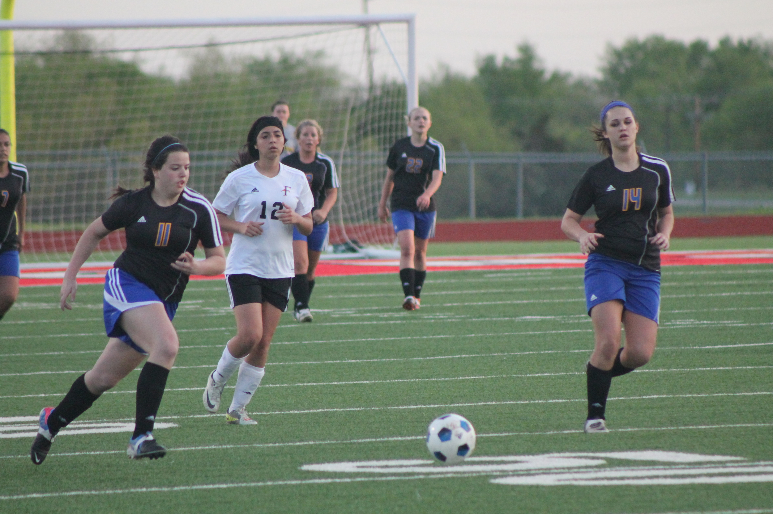 (Photo by Adam Routon) Claire Thompson pushes the ball back upfield.