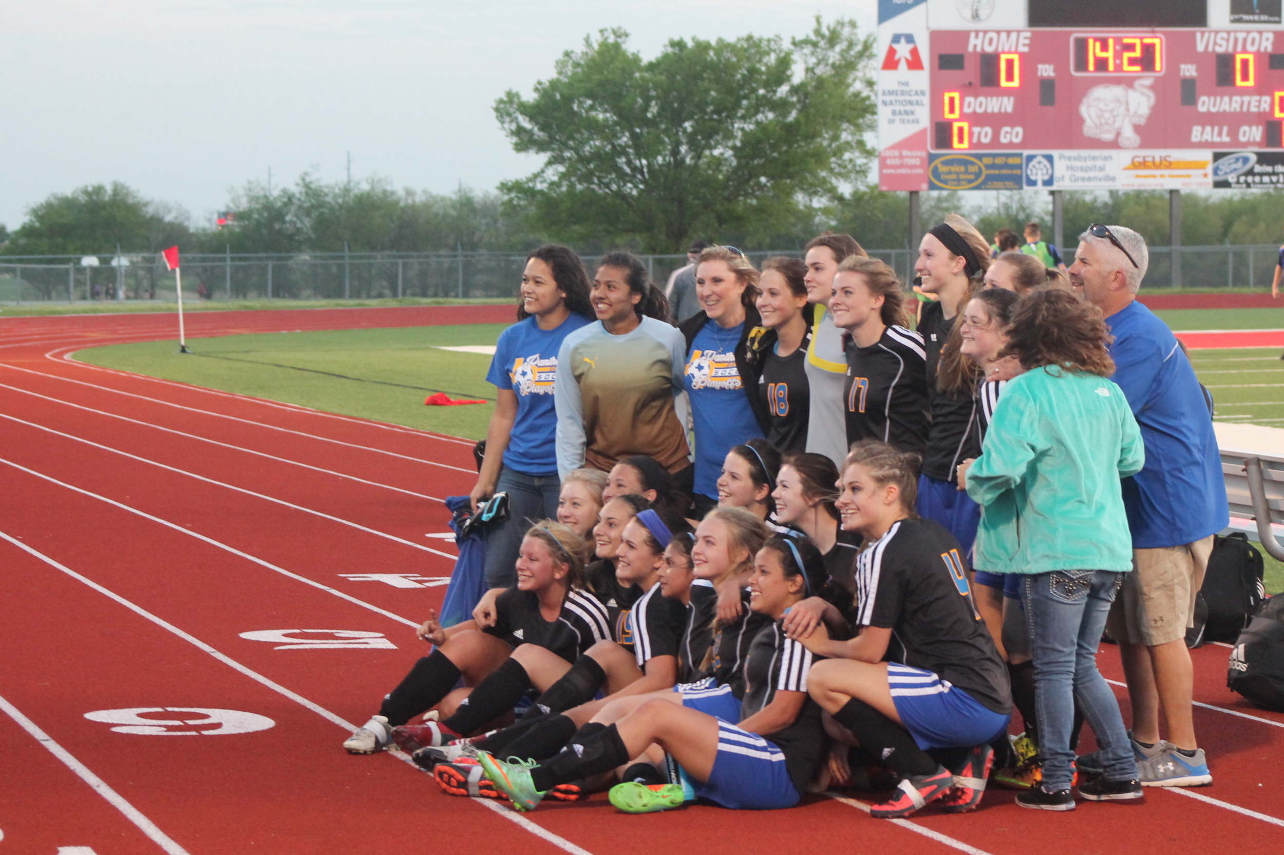 (Photo by Adam Routon) North Lamar posing for pictures after their Area Championship win Friday night.