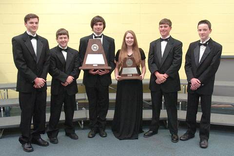 Representing the North Lamar High School band with the UIL Sweepstakes trophies are Josh French, Cody Ashley, Ethan Carter, Alex Phillips, Levi Graham, and Ashton Carter.
