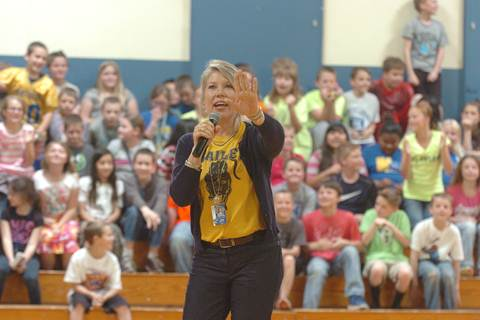 Bailey Principal Angela Compton reacts to the challenge of kissing a pig or a snake set forth by Counselor Keitha Chalupa should the students meet their passing percent goal.