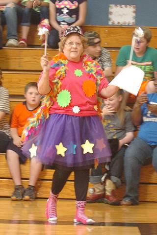 The Bailey STAAR Fairy, aka social studies teacher Anna Linch, sprinkles good luck dust during the 4 th and 5 th grade STAAR pep rally.