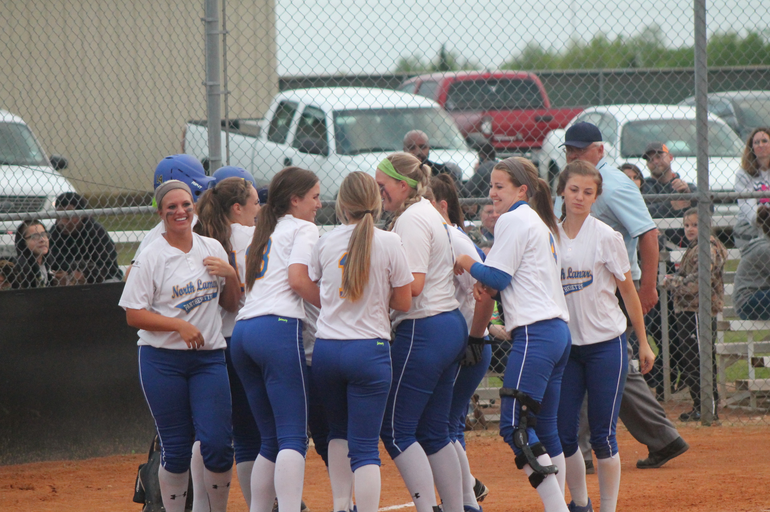 Sarah Penrose being mobbed by her teammates after hitting a two-run homer against Paris High on Tuesday night.