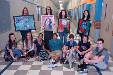 North Lamar High School artists who placed in the Paris Art Fair beginning front row left are Shelby Spears, Hailey Stidham, Kadaja McPeters, Steven Wisham- Peregrina, Rhett Cody, Zeke Wood, and Jeremiah Guenther. In back are Carly McCurry-Porter, Lauren Arnold, Gracie Mullens, and Shalen Haney.