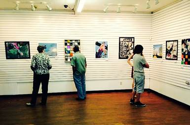 Guests view North Lamar student art at NXS Gallery in Downtown Paris.