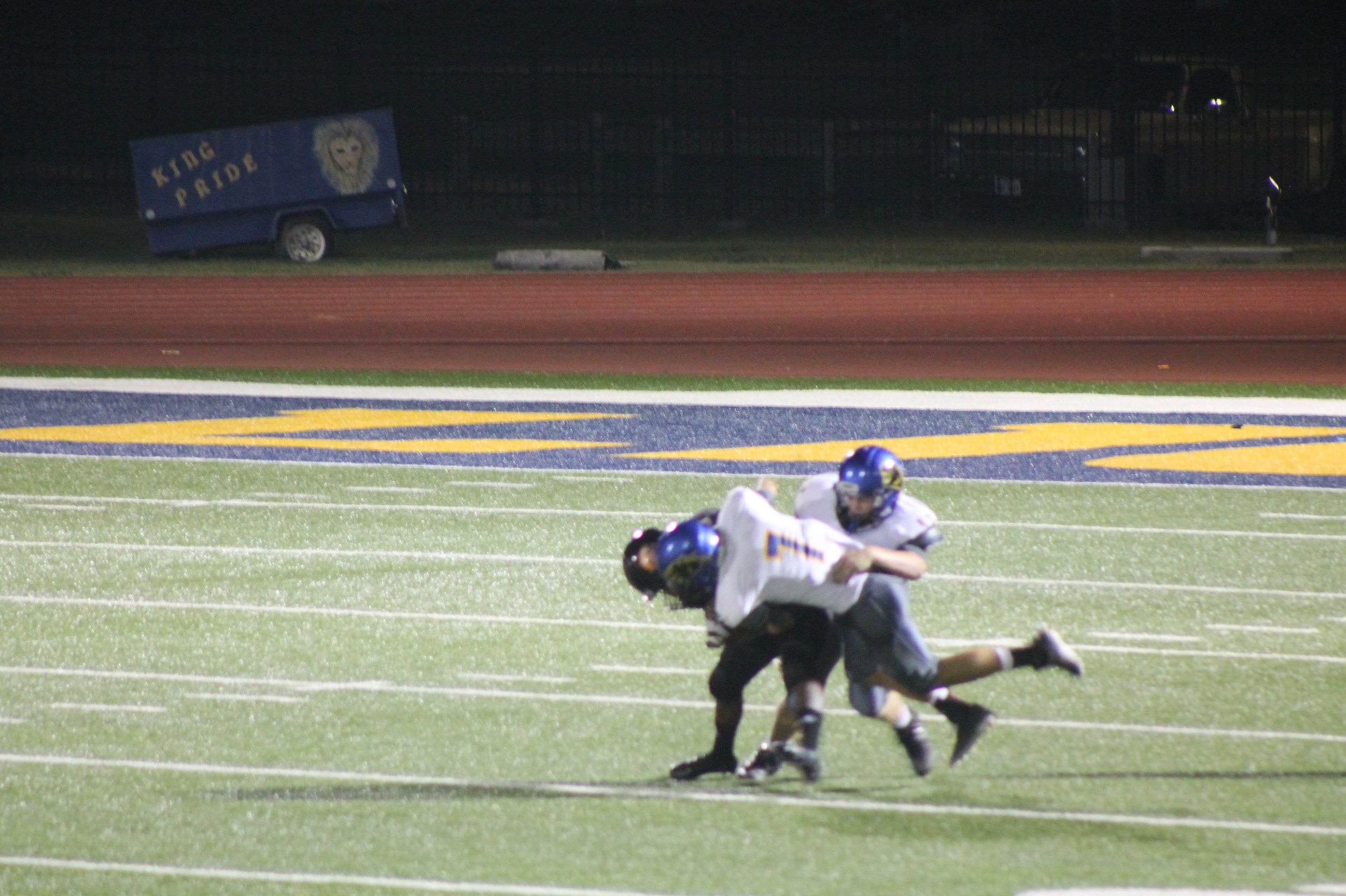 (Photo by Maddy Routon) Trey Scudder (7) and Klayton Drake bringing down a Commerce Player Friday night.