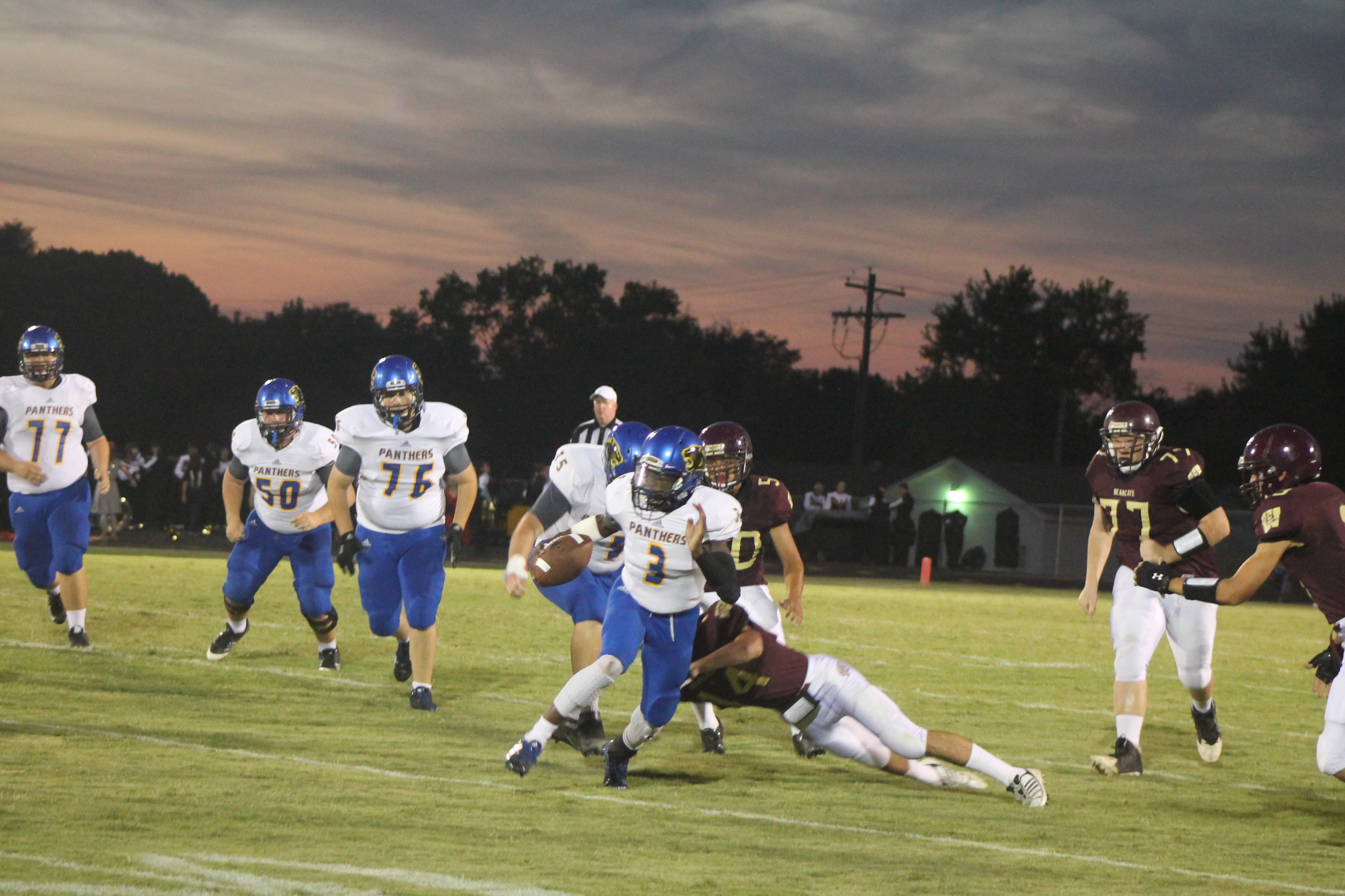 (Photo by Adam Routon) Versache Buchanan (3) escaping a tackle on his way to the end zone for North Lamar.