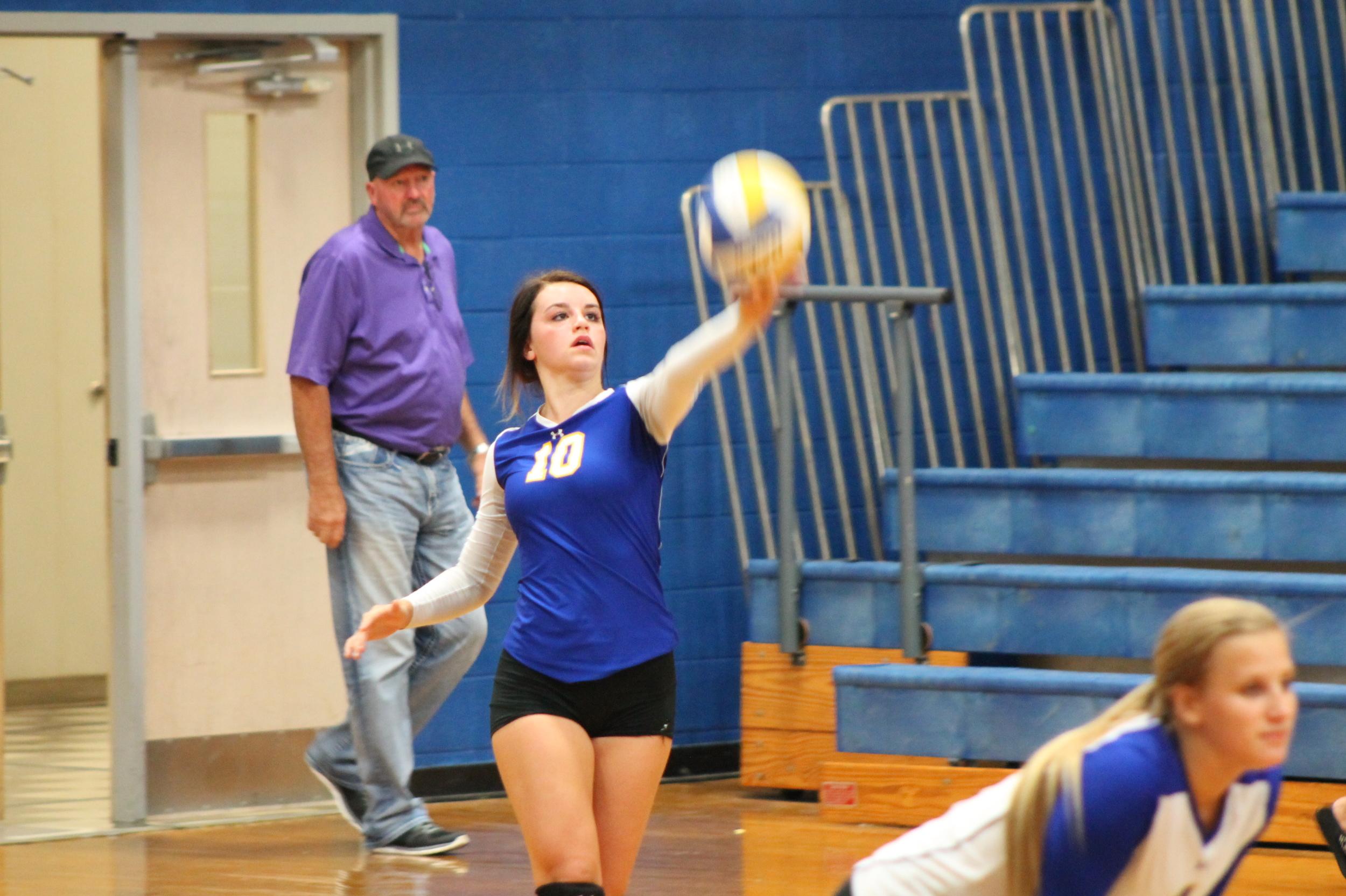 Mara Mabry serving the ball against Melissa