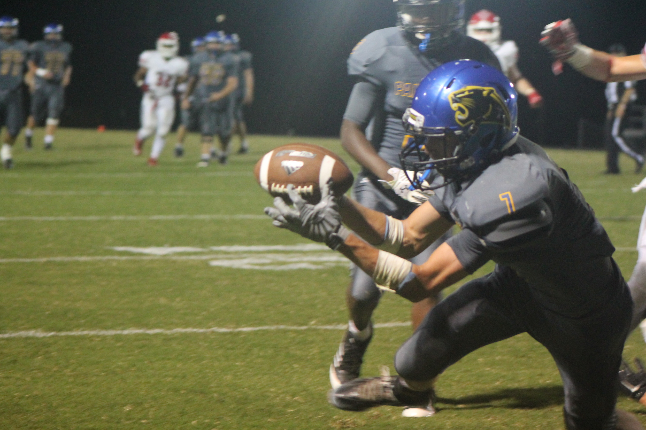 (Photo by Maddy Routon) Trey Scudder with a touchdown reception for North Lamar against Van.