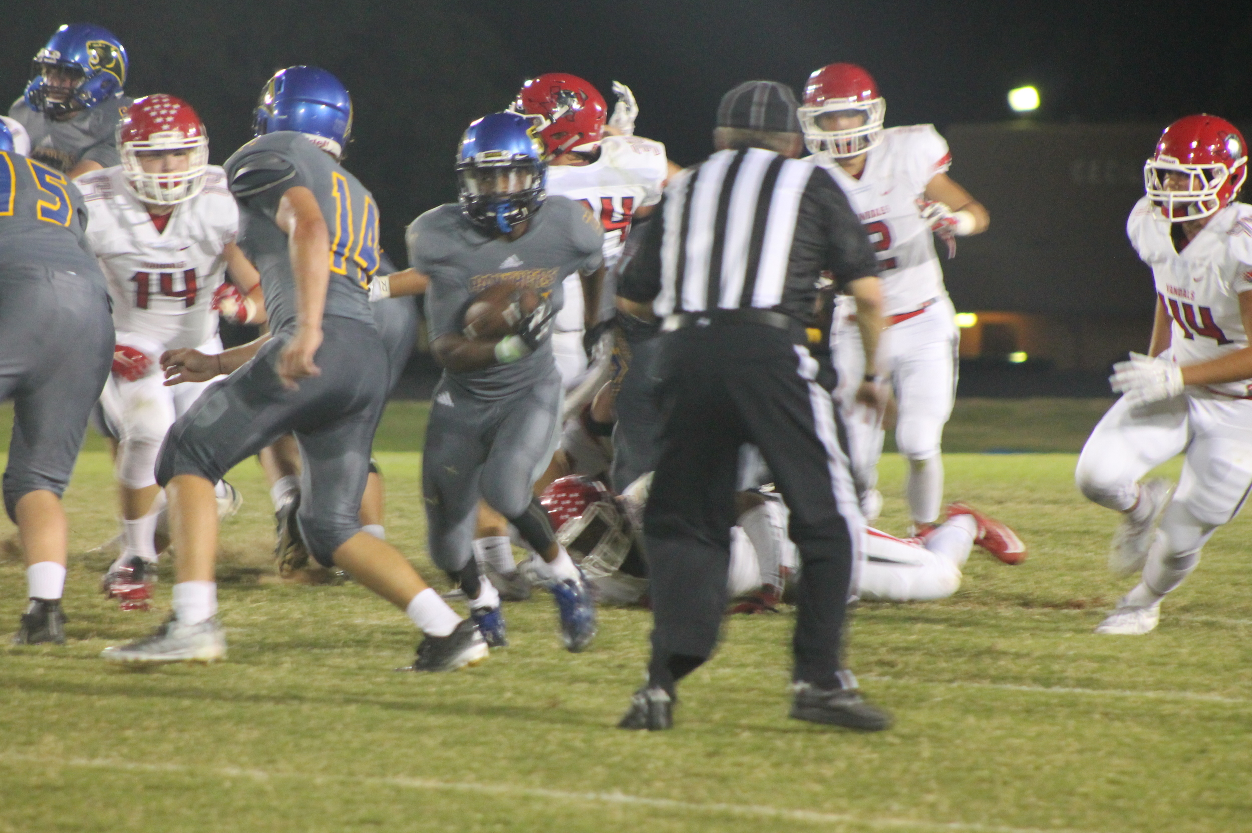 (Photo by Maddy Routon) Javon Franklin cutting through the line against Van.
