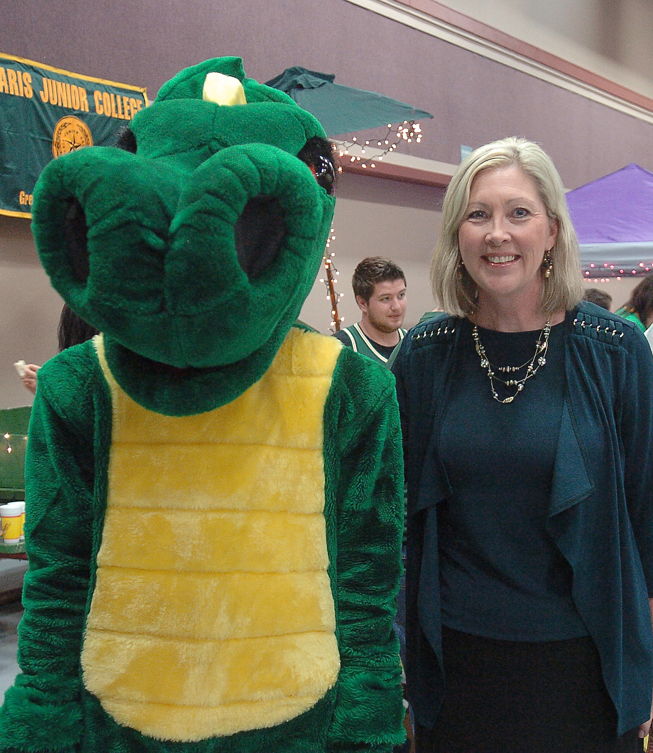 Paris Junior College President Dr. Pamela Anglin, right, accompanied Pyro at the 2014 NLEF Tailgate Scholarship event.