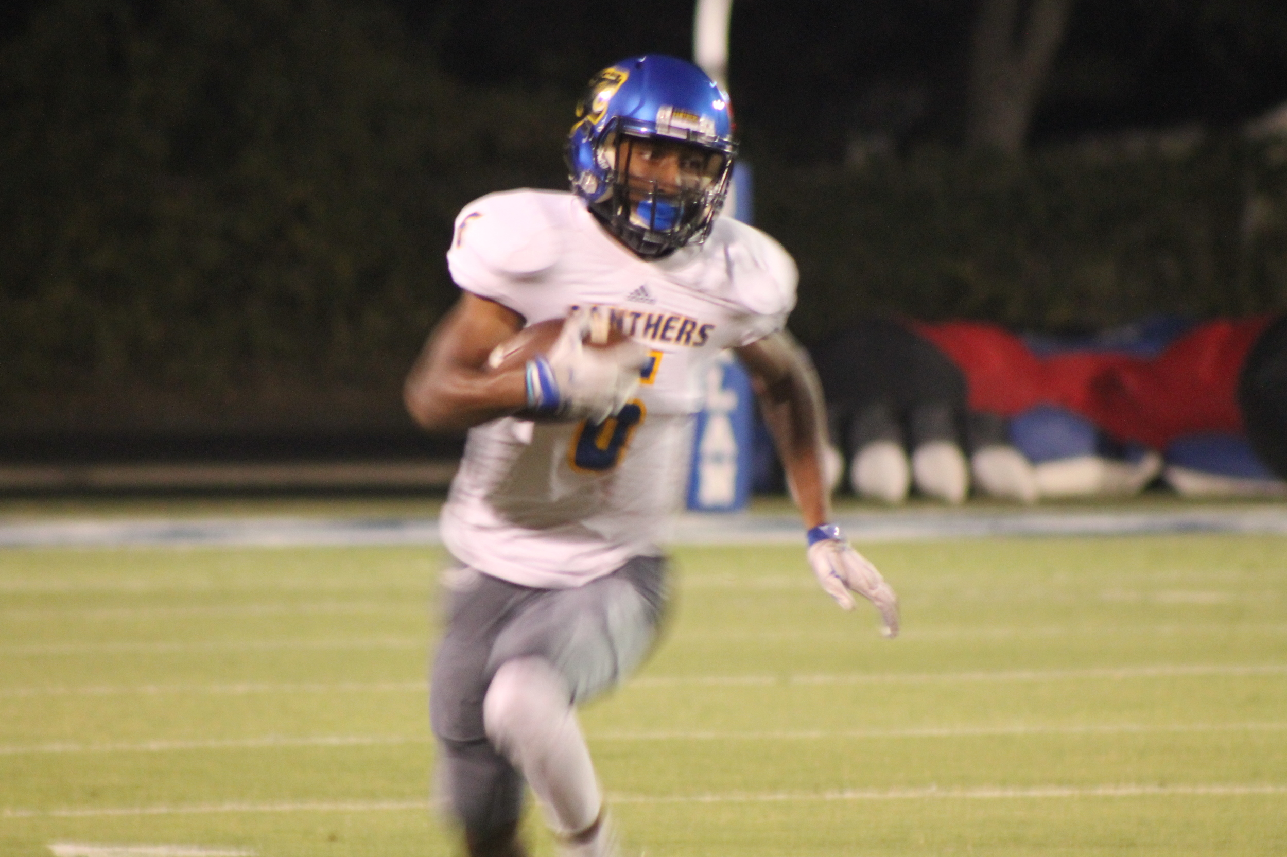 (Photo by Maddy Routon) Julique Franklin running the opening kickoff back 62 yards for a touchdown.