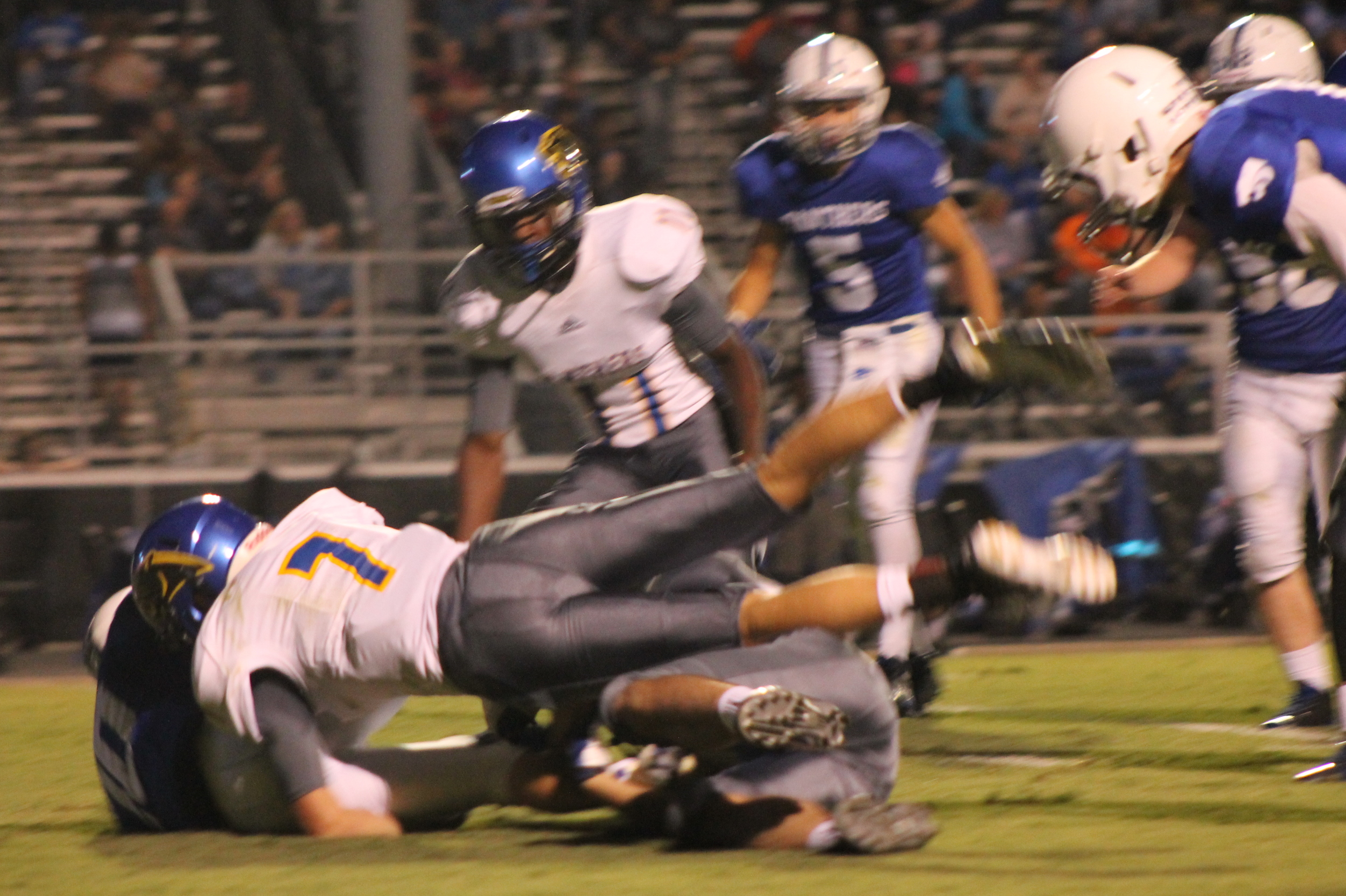 (Photo by Maddy Routon) Trey Scudder (7) making a tackle Friday night as Stephon Bass (11) watches.