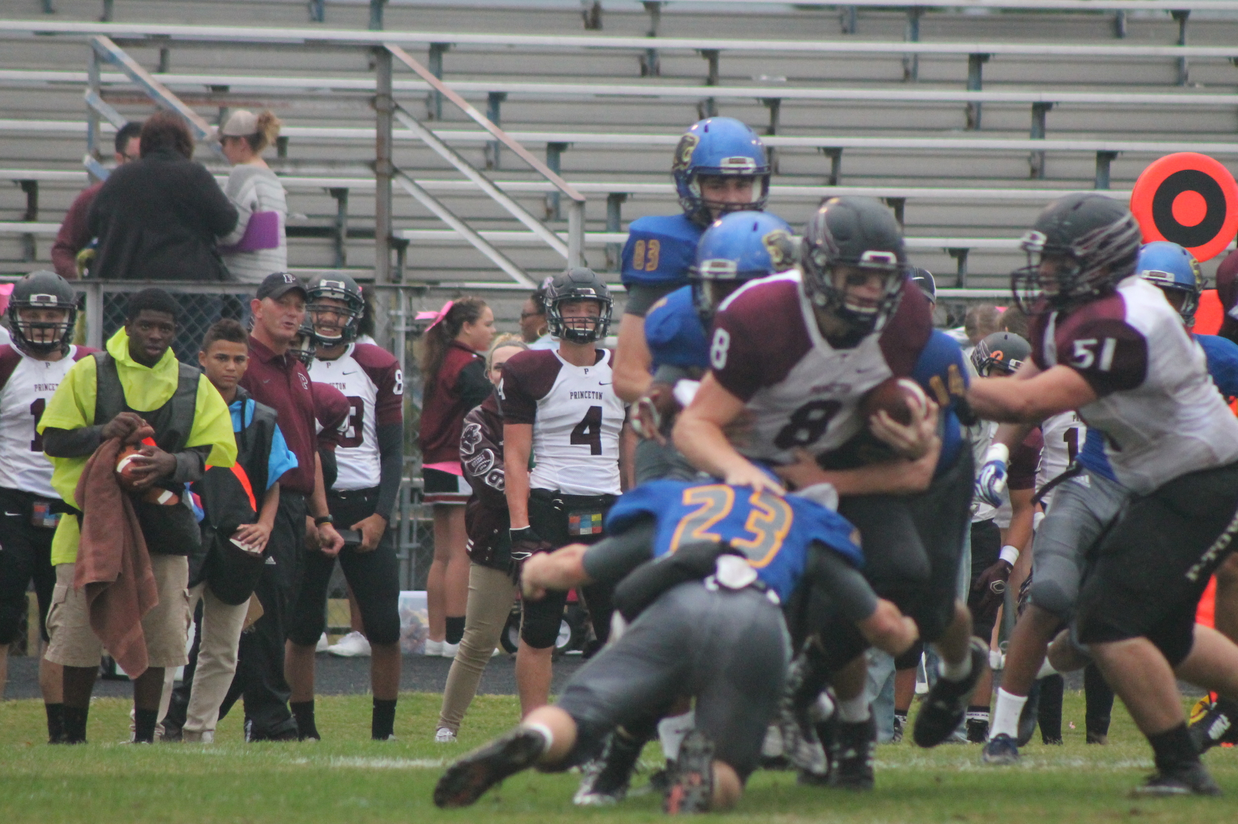(Photo by Maddy Routon) Austin Exum (23) making a tackle on Princeton's quarterback.