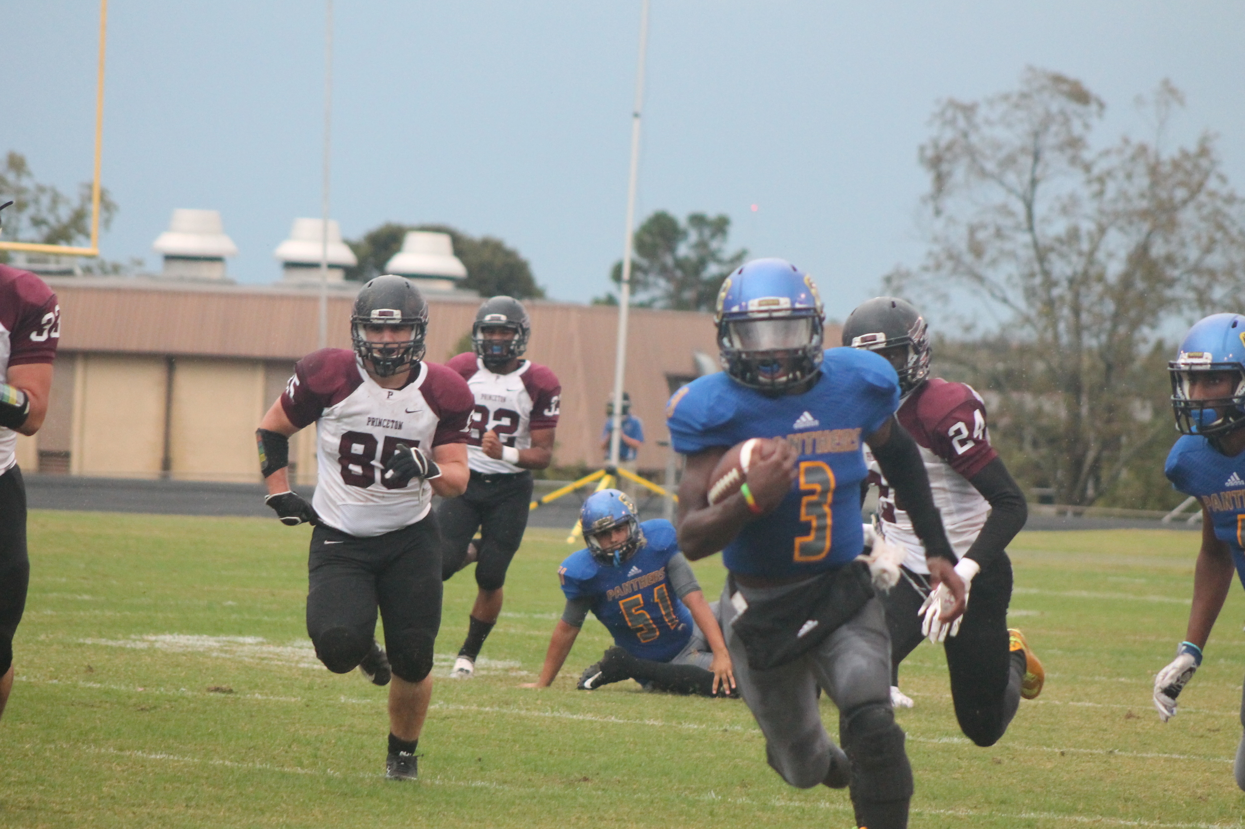 (Photo by Maddy Routon) Versache Buchanan with a touchdown run for North Lamar against Princeton.