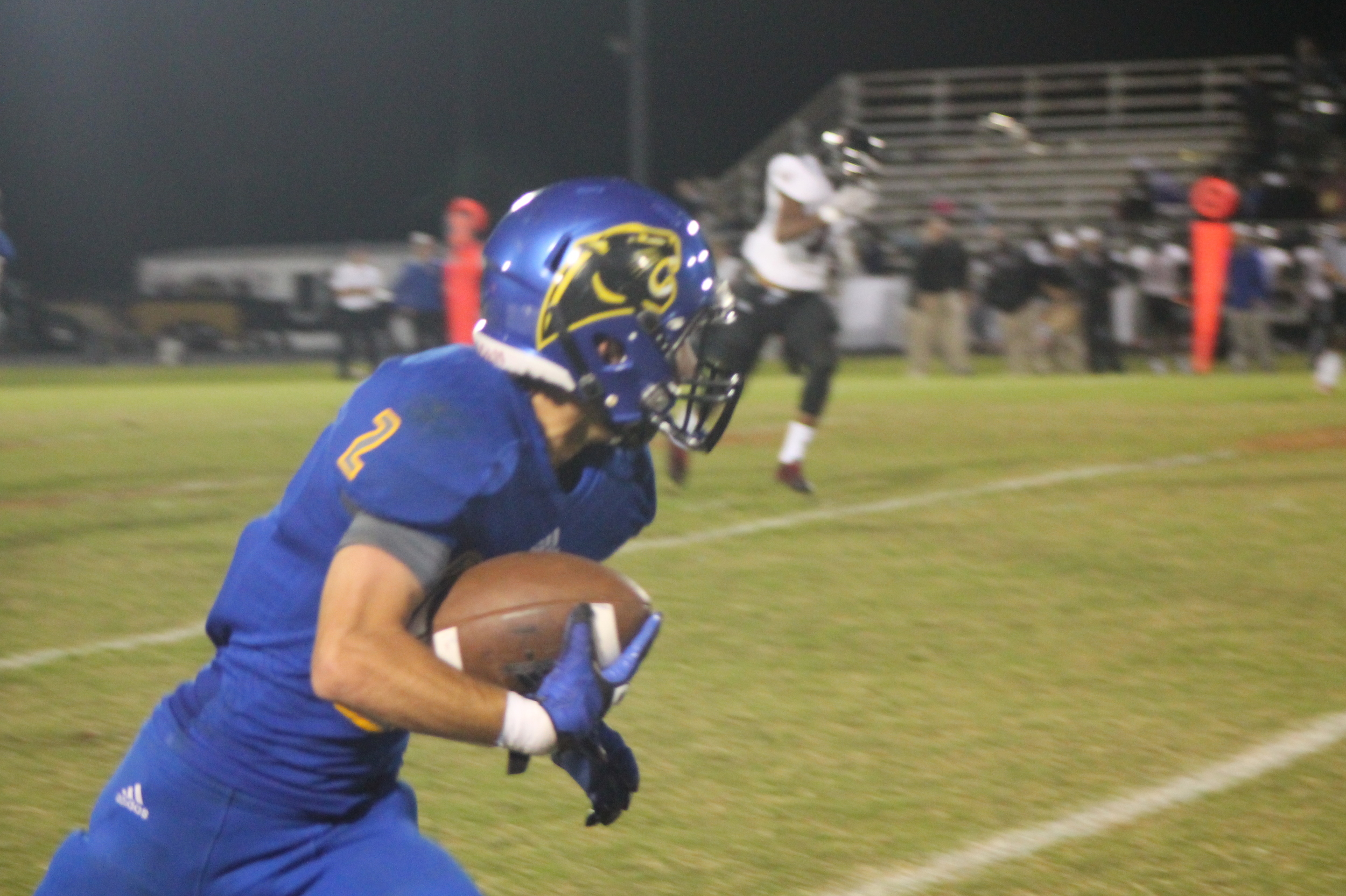 (Photo by Adam Routon) Sam Cowling with a reception and touchdown against LE Thursday night.