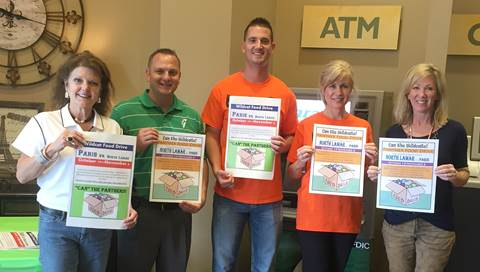 Guaranty Bank & Trust joins as a collection site for the Paris- North Lamar Crosstown Showdown Food Drive.  From left are Jeanne Kraft of PISD, Guaranty representatives Jerimy Bell, Kenny Dority, and Tina Skidmore, and Carla Coleman of NLISD.