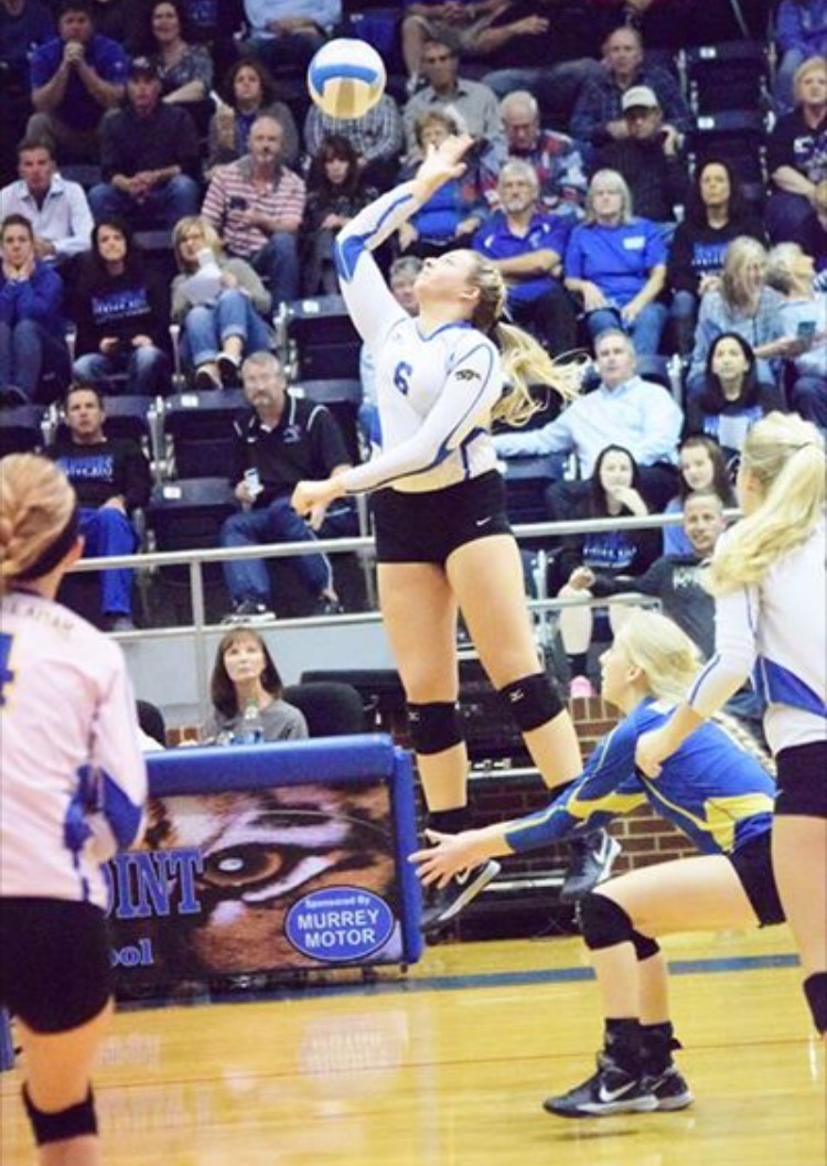 (Photo by Beverly White) Sydney Foy hitting the ball against Spring Hill.