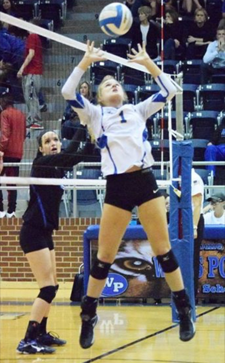 (Photo by Beverly White) Kayla Igleheart setting the ball against Spring Hill.
