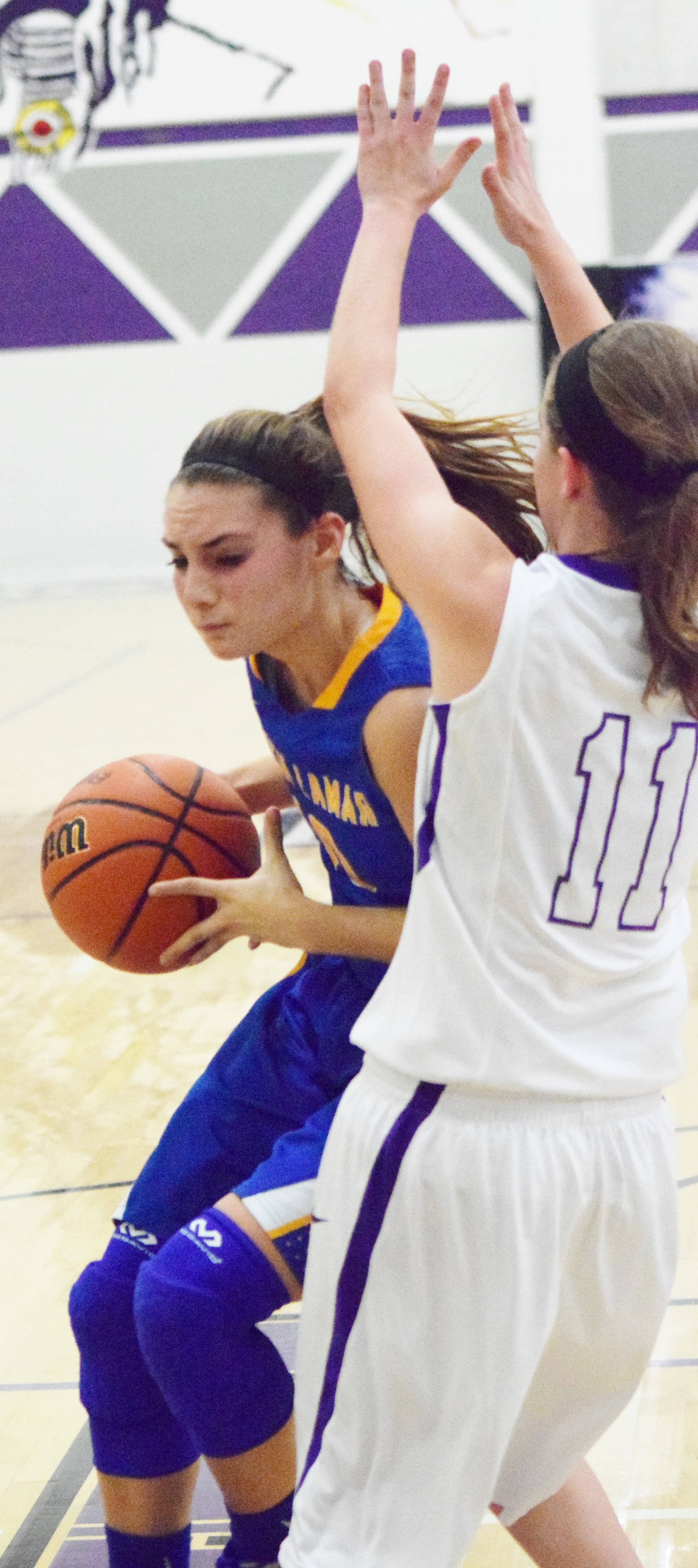 (Photo by Beverly White) Madison Morrison driving against a Bonham defender in the season opener for North Lamar.