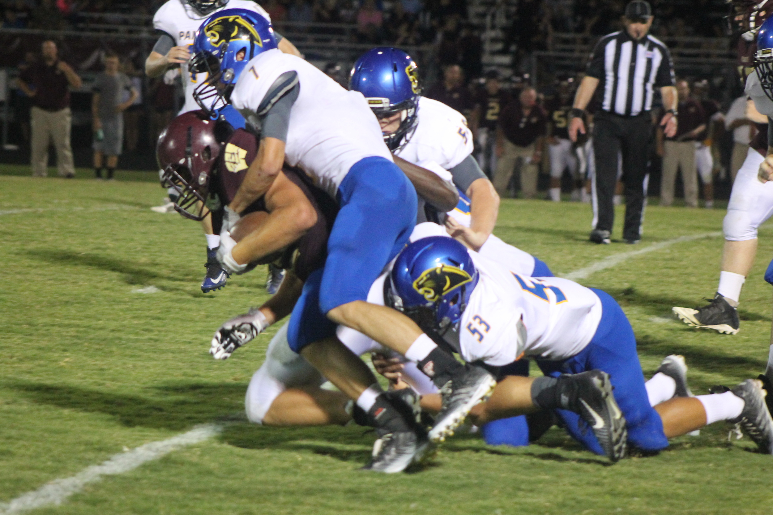 Trey Scudder (7) making a tackle. Scudder was rewarded for his efforts with a First Team All District honor.