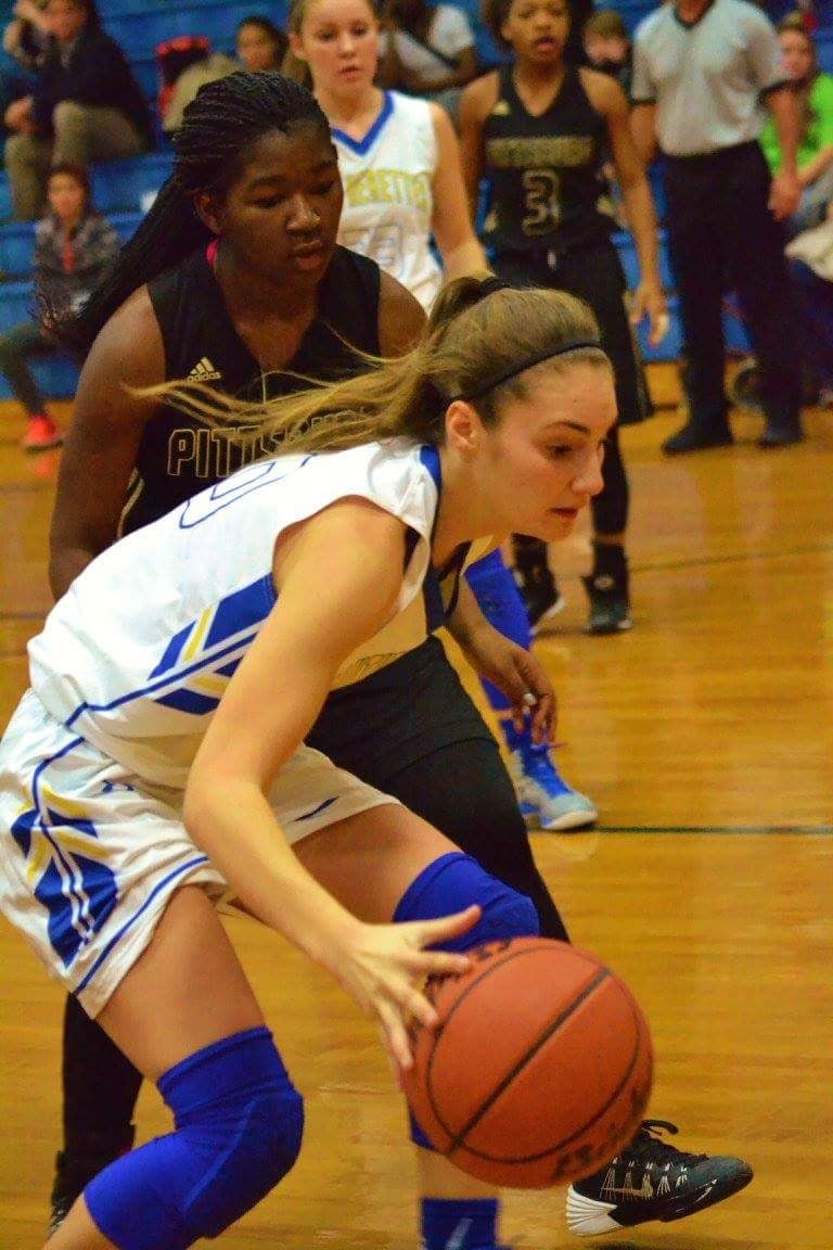 (Photo by Bev White)  Madison Morrison driving past a defender Tuesday night