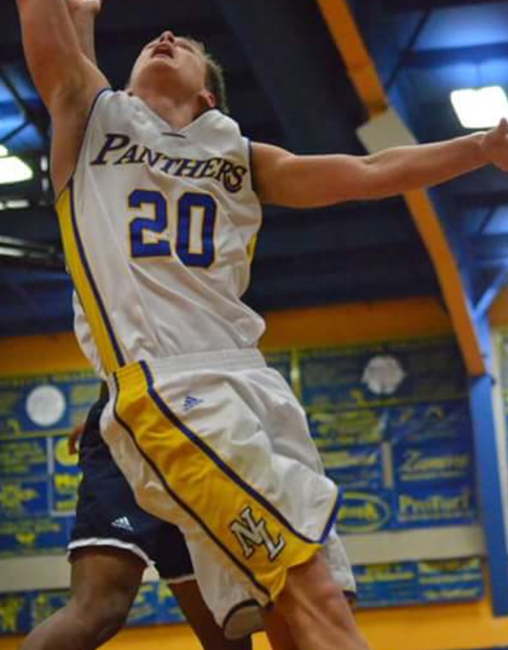 (Photo by Beverly White)Levi Porter with a layup attempt against Paris