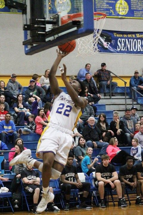 (Photo by Amber Clark) Tyler Hill with a layup for North Lamar against PG