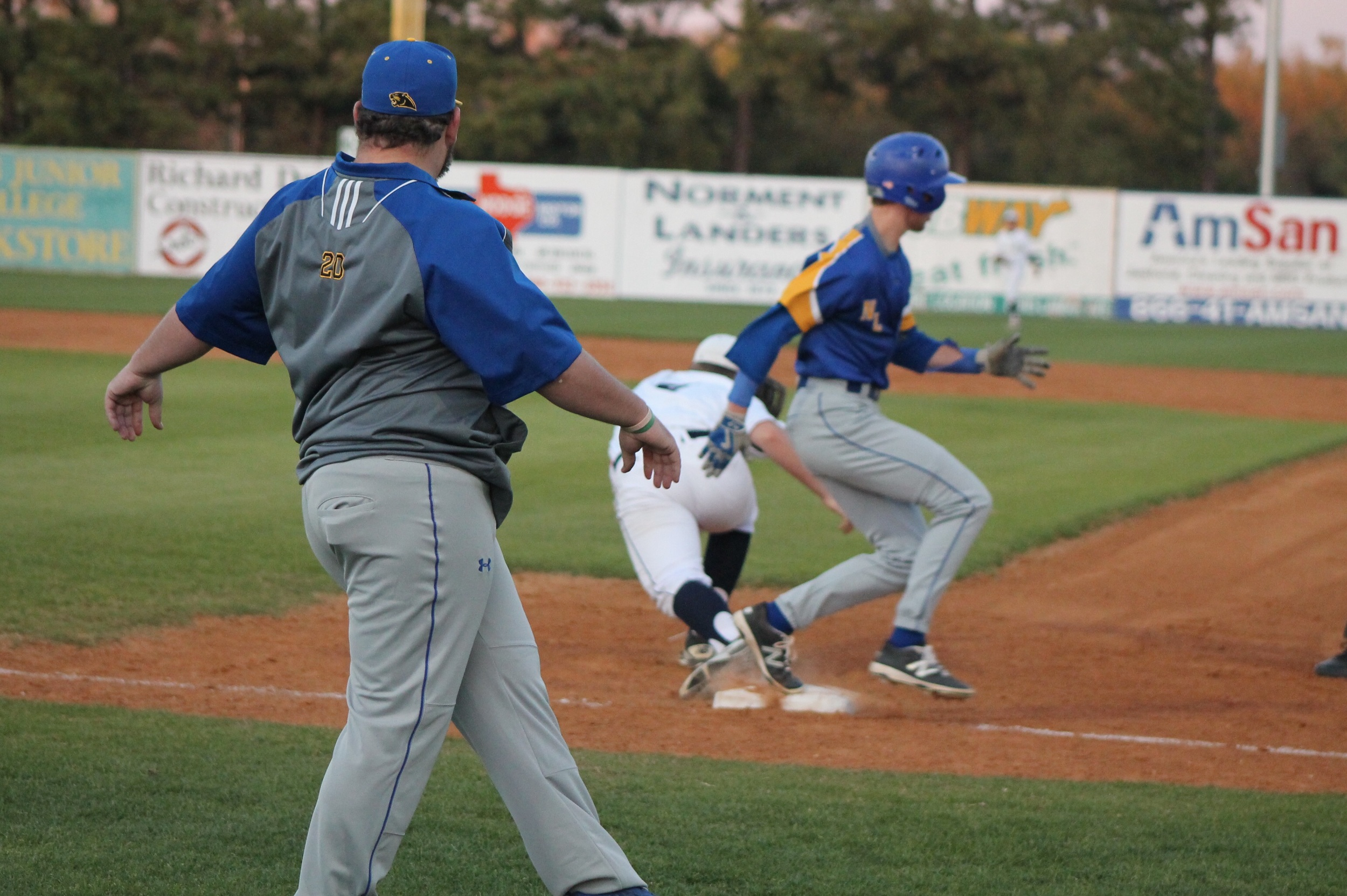 (Photo by Adam Routon) Trey Scudder beating out a grounder earlier in the year.