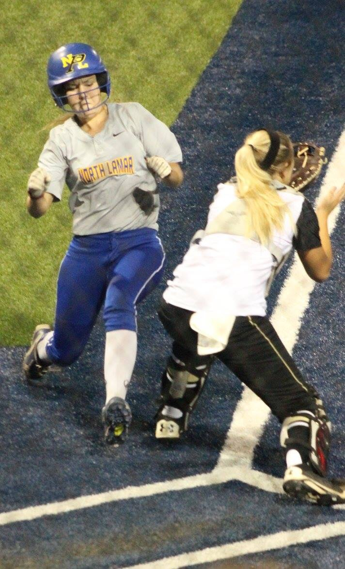 (Photo by Amber Clark) Bailee Nickerson getting around the catcher to score for North Lamar.