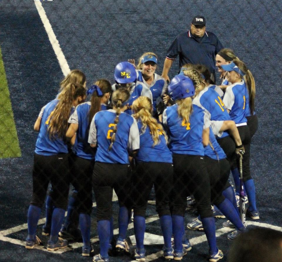 (Photo by Amber Clark) Summer Andrews being congratulated by her team after hitting a solo Home Run against Pleasant Grove.