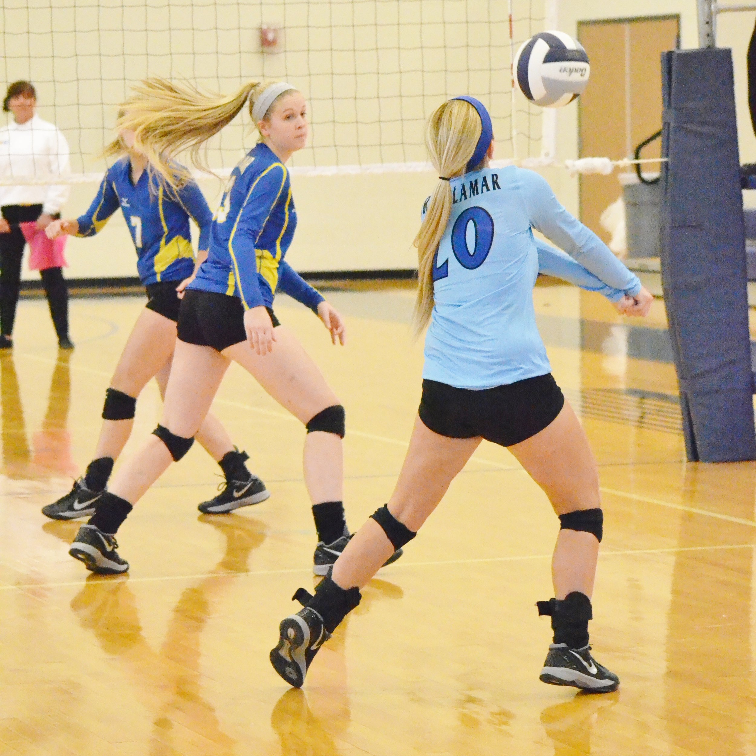 (photo by Beverly White) Natalie Allen (20) hitting the ball as Amber White looks on.