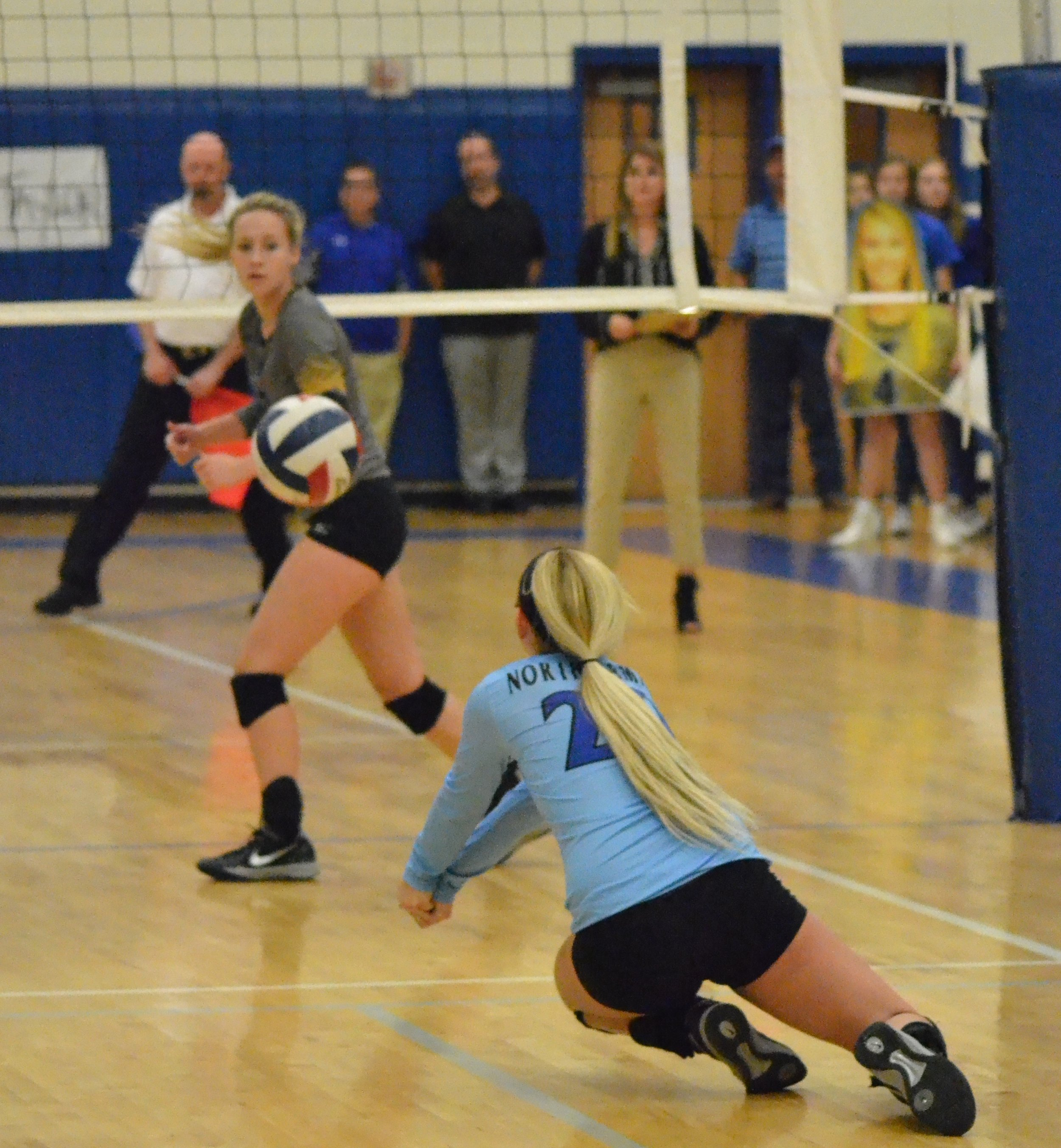 (Photo by Beverly White) Natalie Allen (20) diving for the ball as Haley Porter watches.